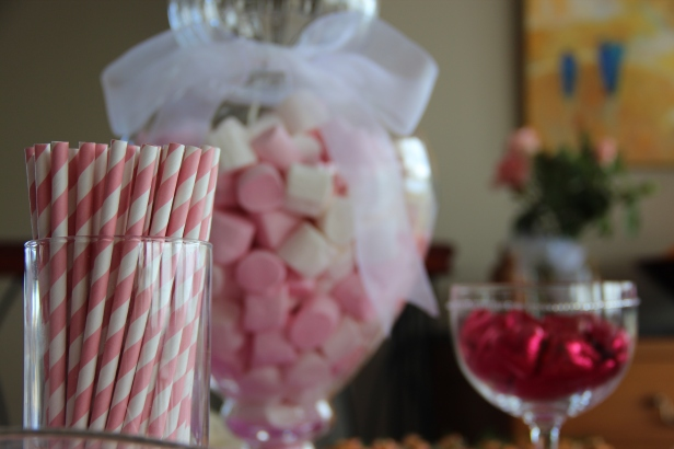 A string of self-adhesive diamantes jazzed up a tall-stemmed glass filled with pink foil chocolate hearts