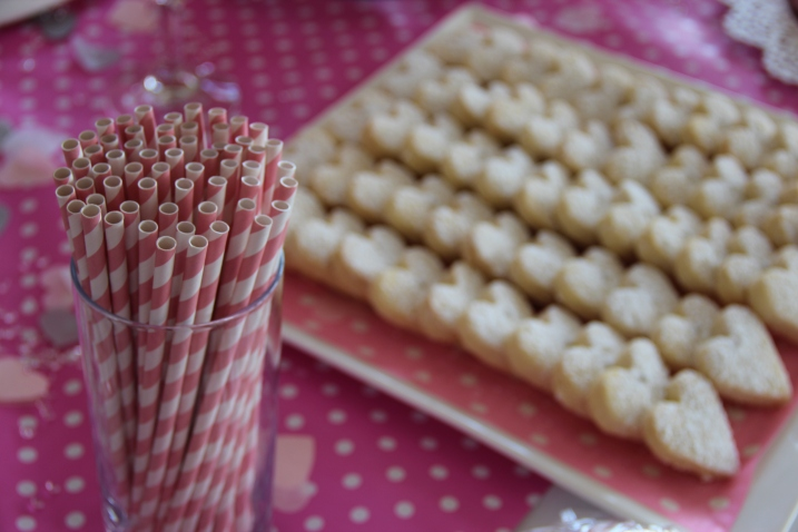 Pink straws and love heart shaped shortbread